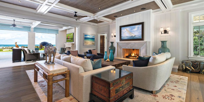 The living area can be opened to the backyard and the ocean by way of pocket sliding glass doors